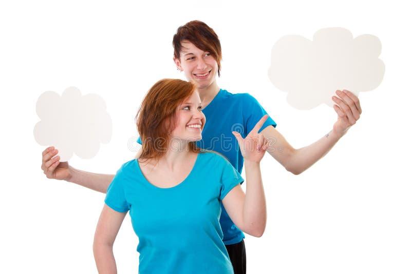 Jovens com sinais vazios fotos de stock