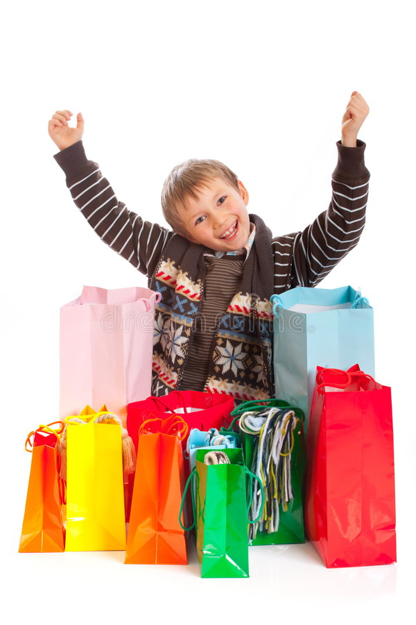 Download Jovial Boy With Shopping Bags Stock Image - Image: 8188569