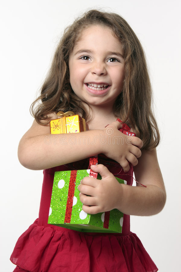 Jovial happy girl child holding presents royalty free stock photos