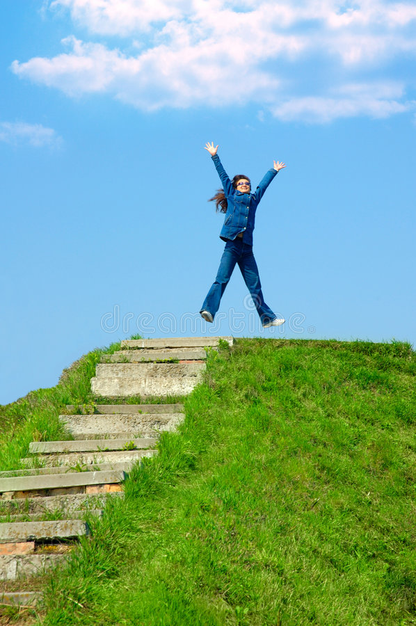Joy 1. Young woman jumping from joy stock photography