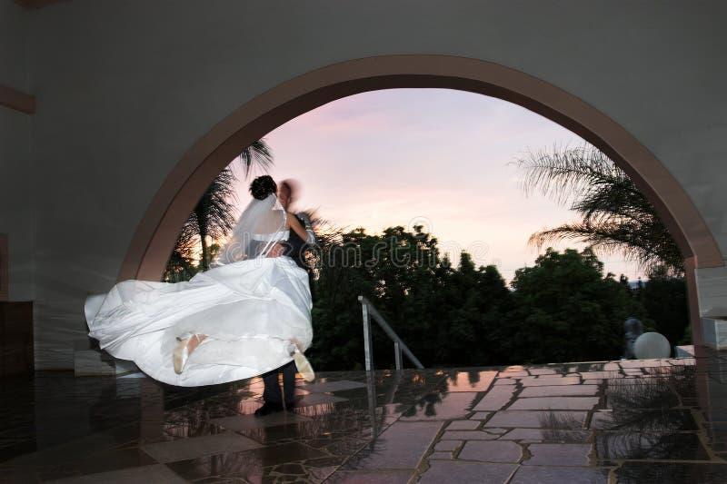 Joy. Groom swinging his bride