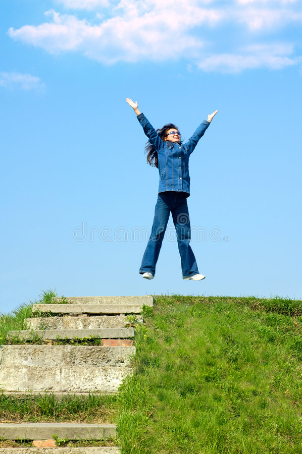 Joy 2. Young girl teenager jumping from joy royalty free stock images