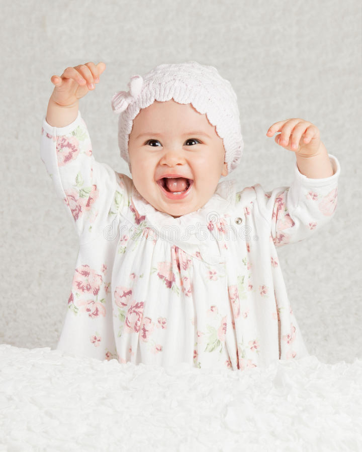 Joy. Studio high key portrait of a happy infant girl royalty free stock photography
