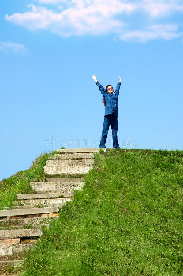 Joy 3. Happy young woman on a hill royalty free stock photography