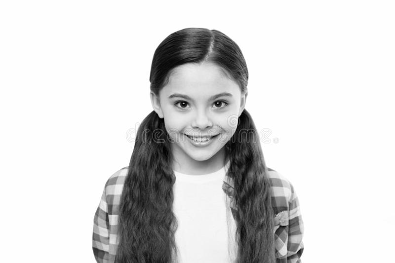 The joy of best hair. Happy girl with stylish ponytail hairstyle. Cute girl smile with new hairstyle. Little child with. Long locks of hair. Small beauty model stock photo