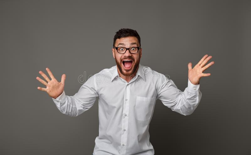 Young excited man in glasses and happy screaming royalty free stock photography