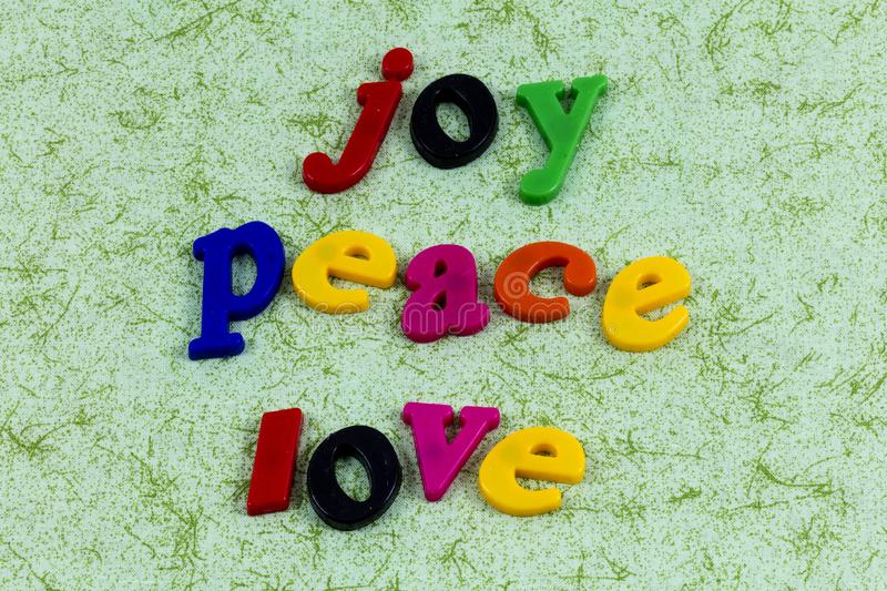 Joy peace love hope faith kindness religion helping others. Letterpress message children help be kind karma enjoy life royalty free stock photography