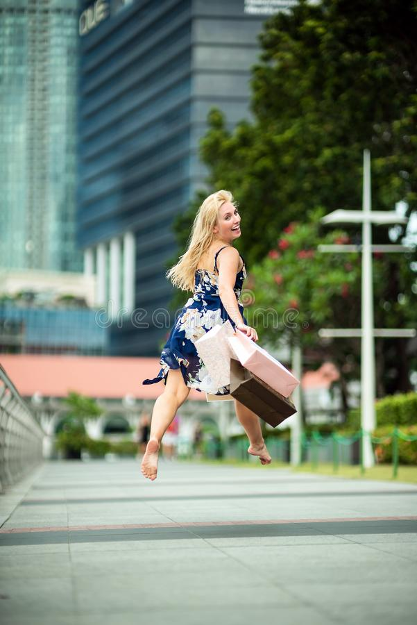 The Joy of Shopping... Excited Beautiful Woman on air, wearing c royalty free stock images