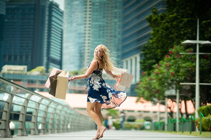 The Joy of Shopping... Excited Beautiful Woman wearing casual b royalty free stock photo