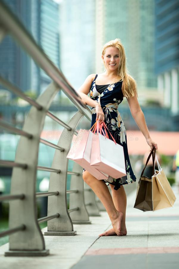The Joy of Shopping... Excited Beautiful Woman wearing casual b stock photo