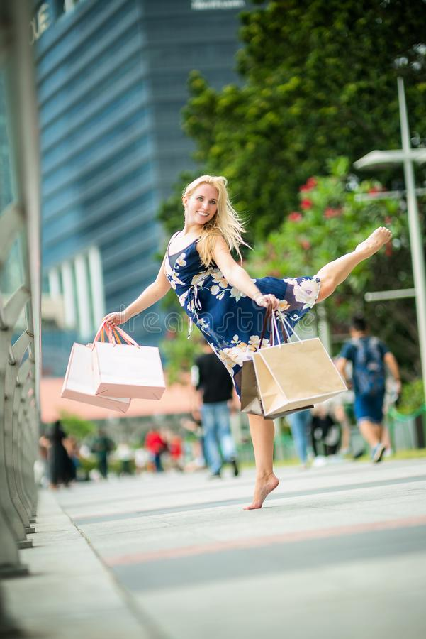 The Joy of Shopping... Excited Beautiful Woman wearing casual b stock photography