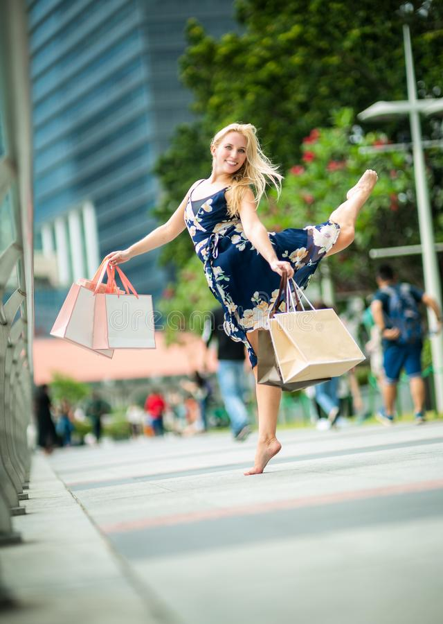 The Joy of Shopping... Excited Beautiful Woman wearing casual b stock images