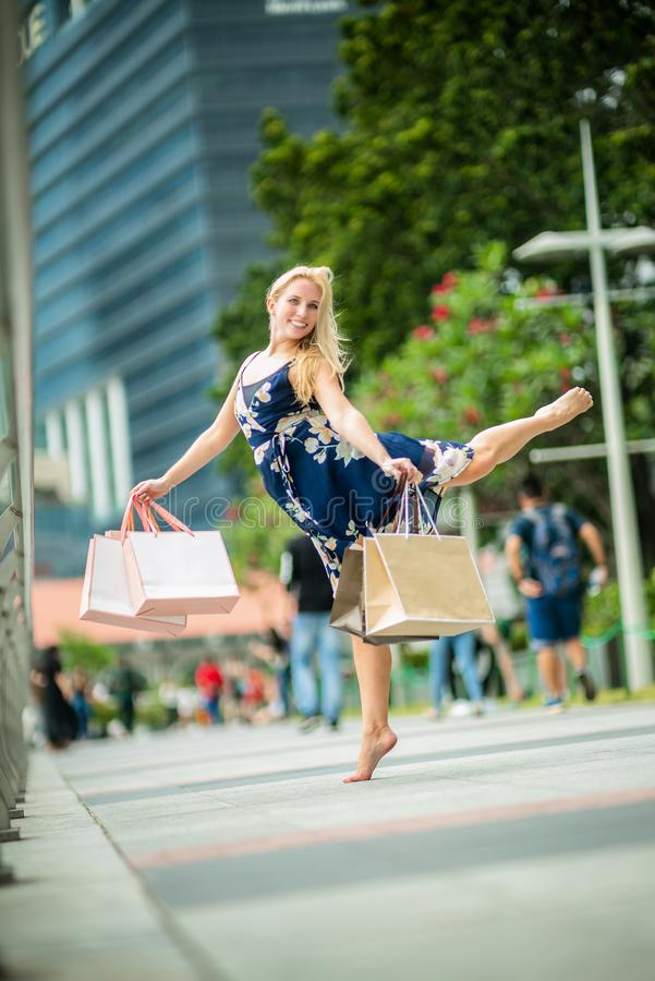 The Joy of Shopping... Excited Beautiful Woman wearing casual b stock image