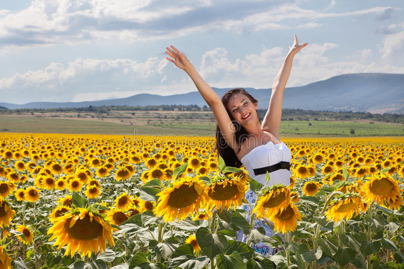 Joy in a sunflower field royalty free stock images