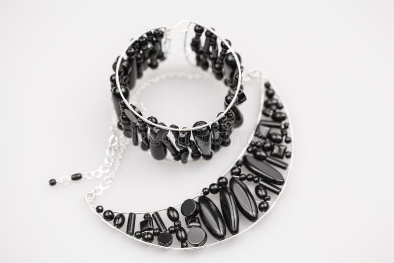 Joyas de plata con las piedras del ónix imágenes de archivo libres de regalías