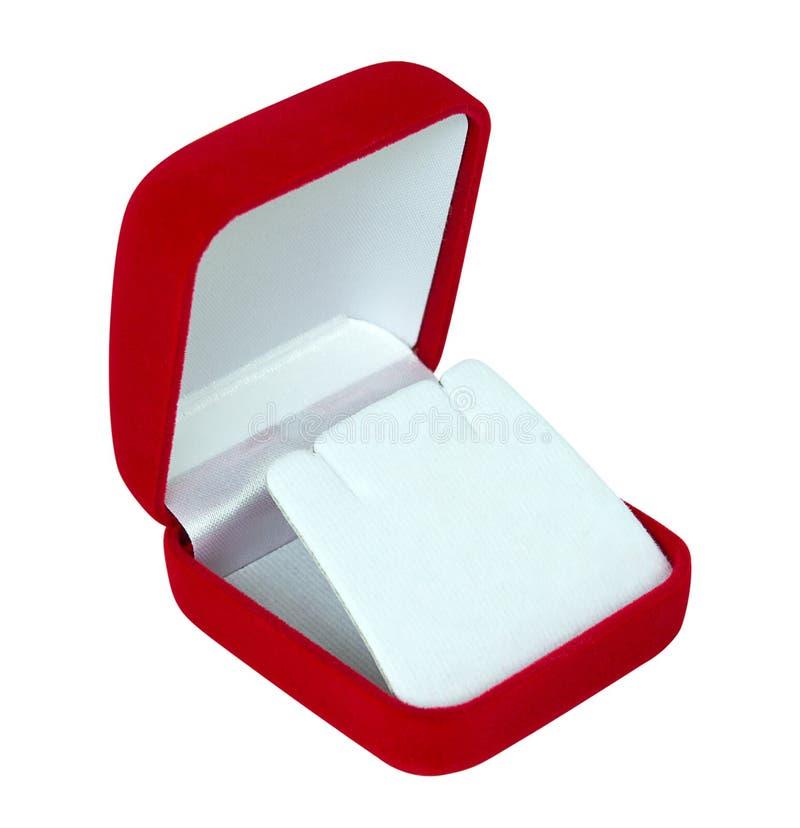 Joyero vacío rojo aislado en el fondo blanco, palmadita que acorta imagen de archivo