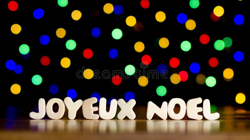 Joyeux Noel, Feliz Navidad en lengua francesa foto de archivo