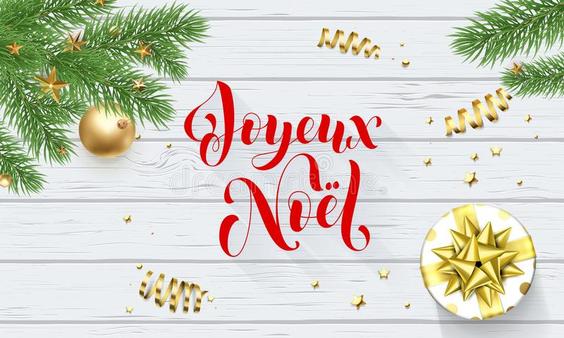Joyeux Noel French Merry Christmas golden decoration and calligraphy font on white wooden background for greeting card. Vector Chr. Istmas or New Year gold shiny royalty free illustration