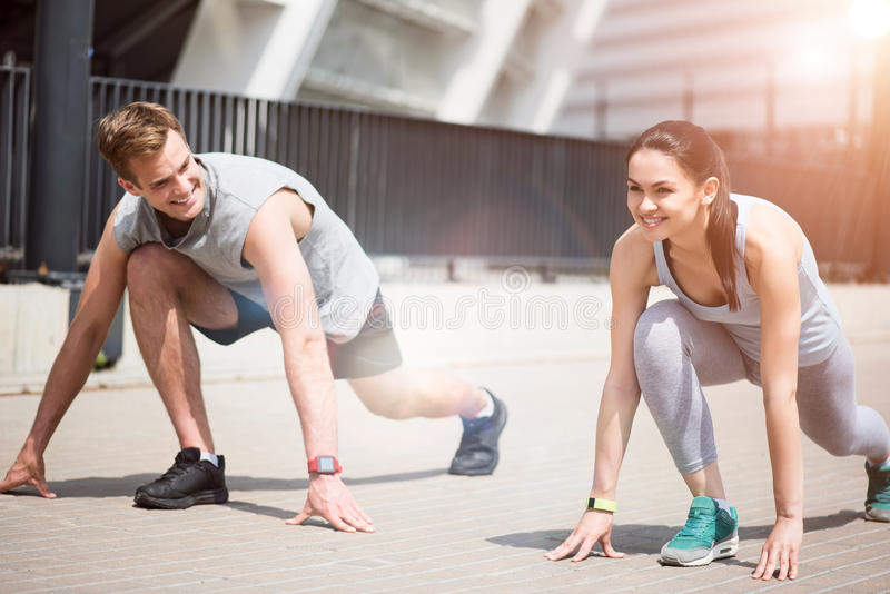 Joyful active people preparing for a run together. royalty free stock image