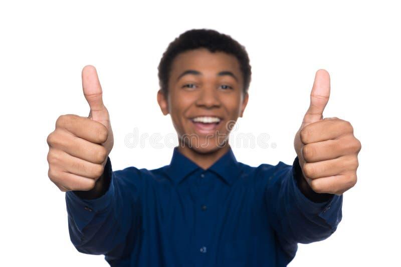 Joyful Afro American teen showing thumbs up stock image