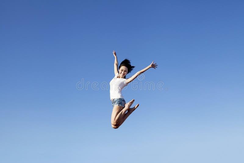 Joyful asian woman jumping royalty free stock photos