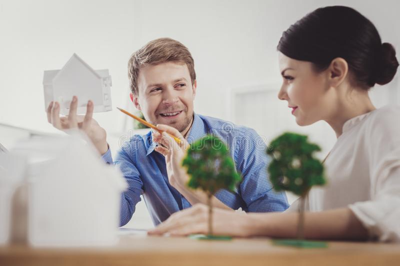 Joyful attractive woman talking to her colleague royalty free stock images
