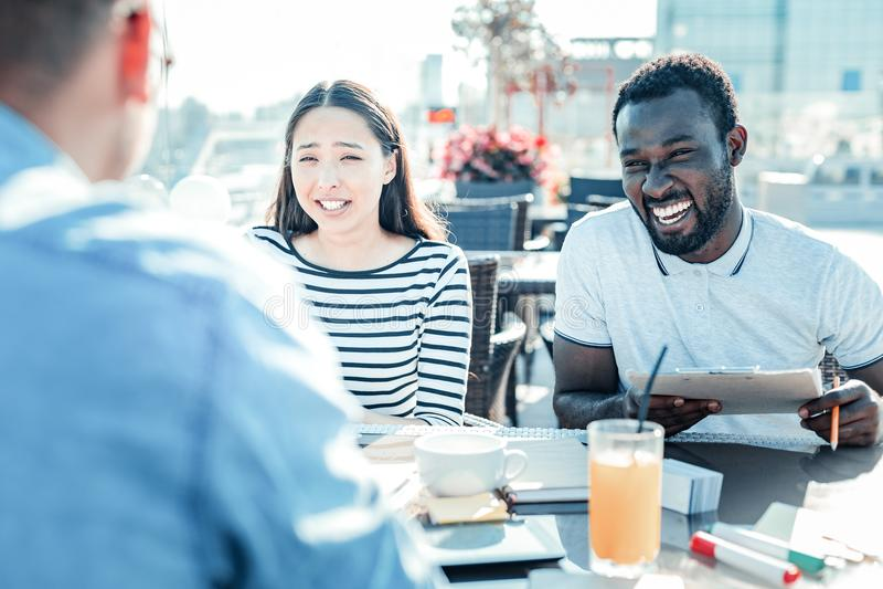 Joyful bearded man laughing at joke stock image