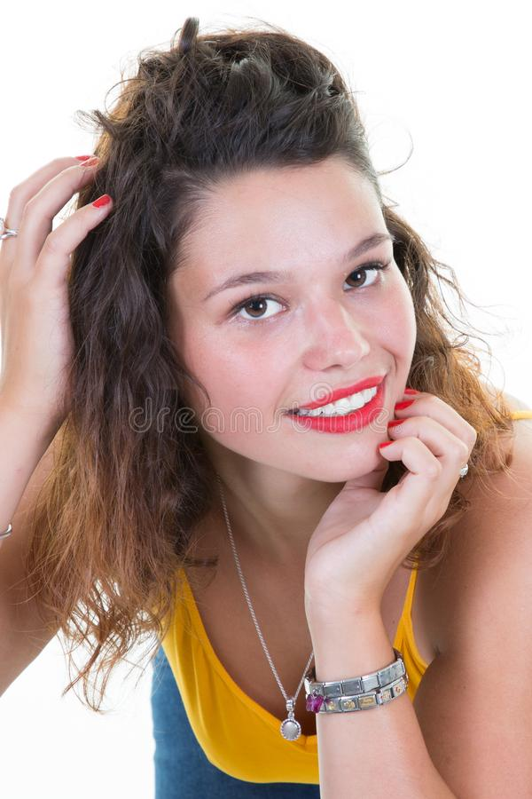 Beautiful caucasian woman with curly hairstyle wearing t-shirt yellow expressing cheer and good mood against white background stock photos