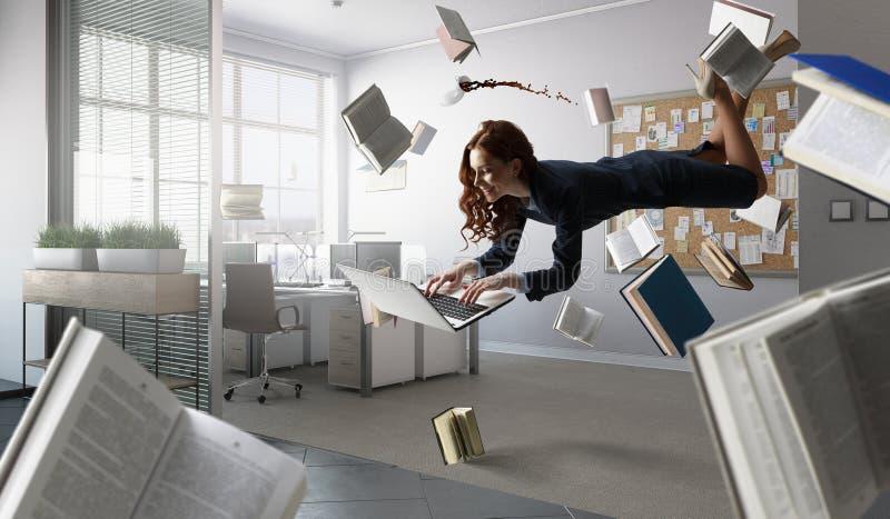 Joyful beautiful young levitating businesswoman royalty free stock image