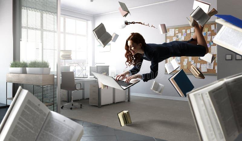 Joyful beautiful young levitating businesswoman royalty free stock photo