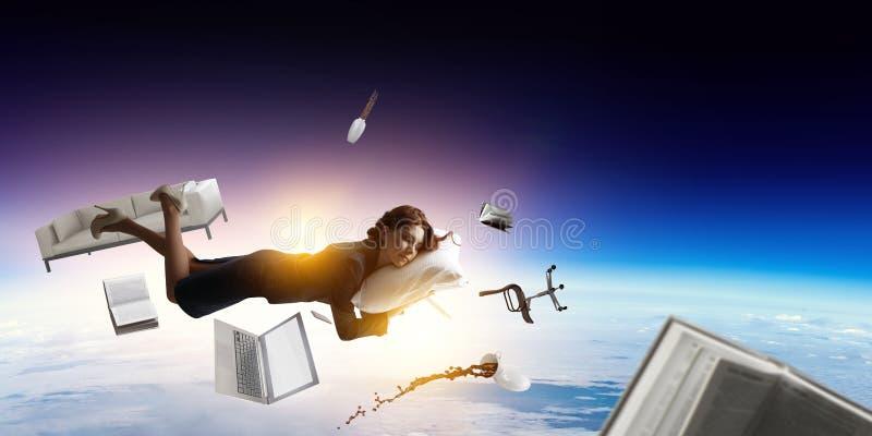 Joyful beautiful young levitating businesswoman royalty free stock images