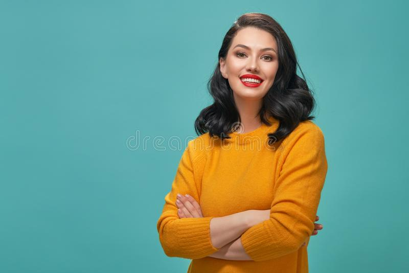 Woman on teal background stock photo