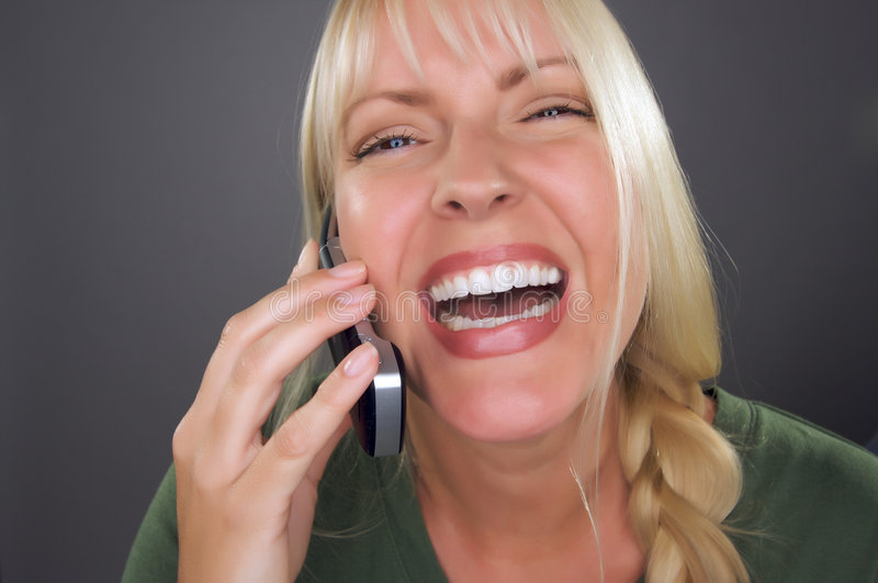Download Joyful Blond Woman Using Cell Phone Stock Photo - Image of expression, call: 7746330