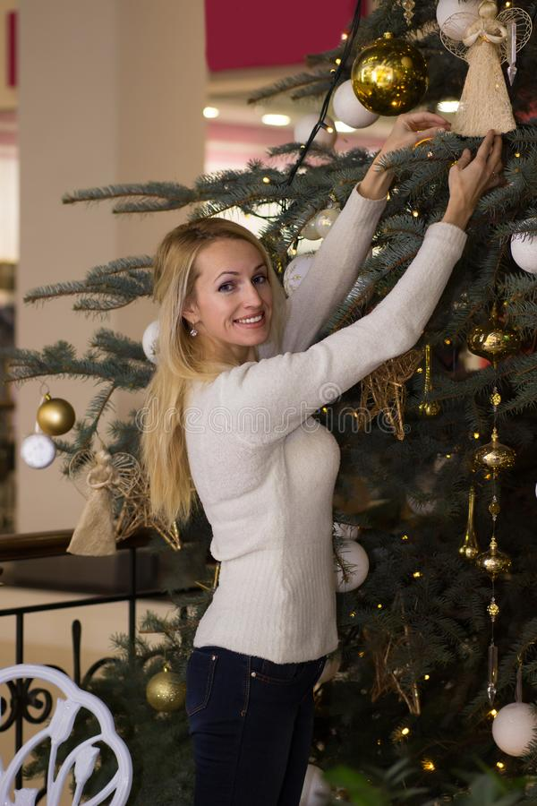 Joyful long hair woman celebration Christmas. Joyful blonde long hair woman celebration Christmas stock photography