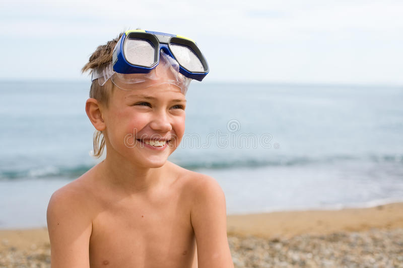 Boy in a mask for scuba diving. stock photo