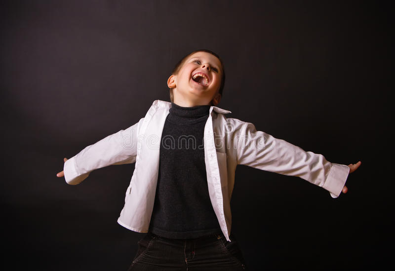 Joyful Boy on a Black Background royalty free stock photo