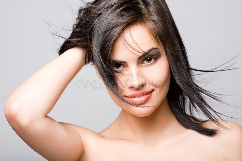 Joyful brunette beauty.