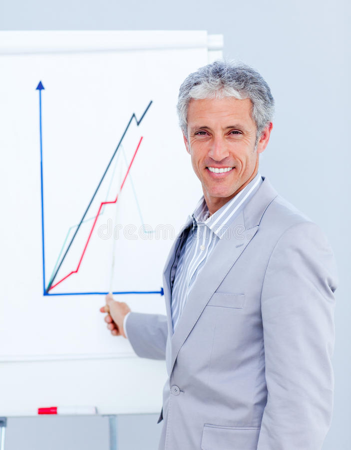Joyful businessman giving a presentation stock image