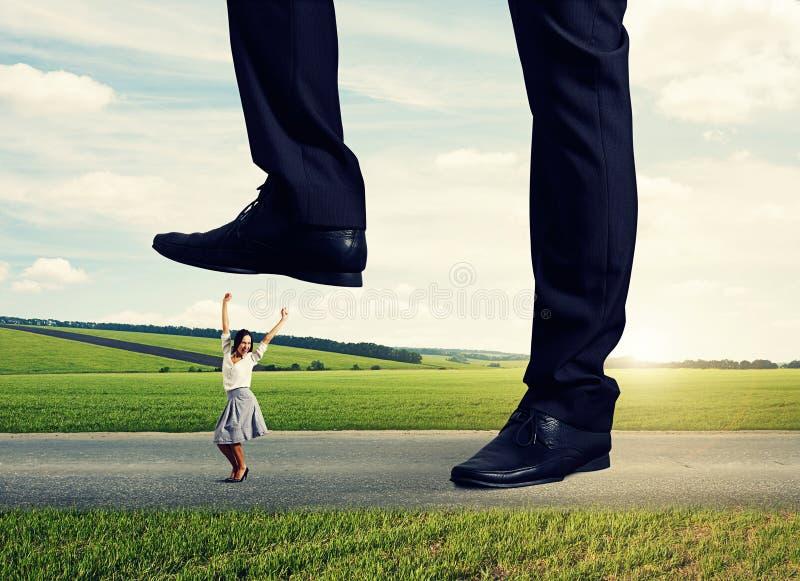 Joyful Businesswoman Under Big Leg Stock Photo
