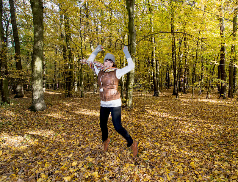 Download Joyful Caucasian Woman Jumping In The Autumn Leaves Royalty Free Stock Photos - Image: 34568338