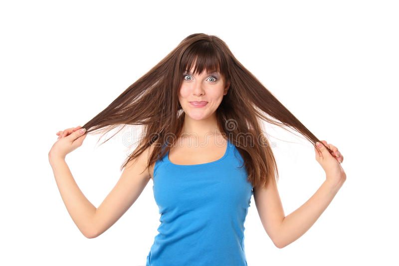 Joyful and cheerful girl clings to her hair royalty free stock photos