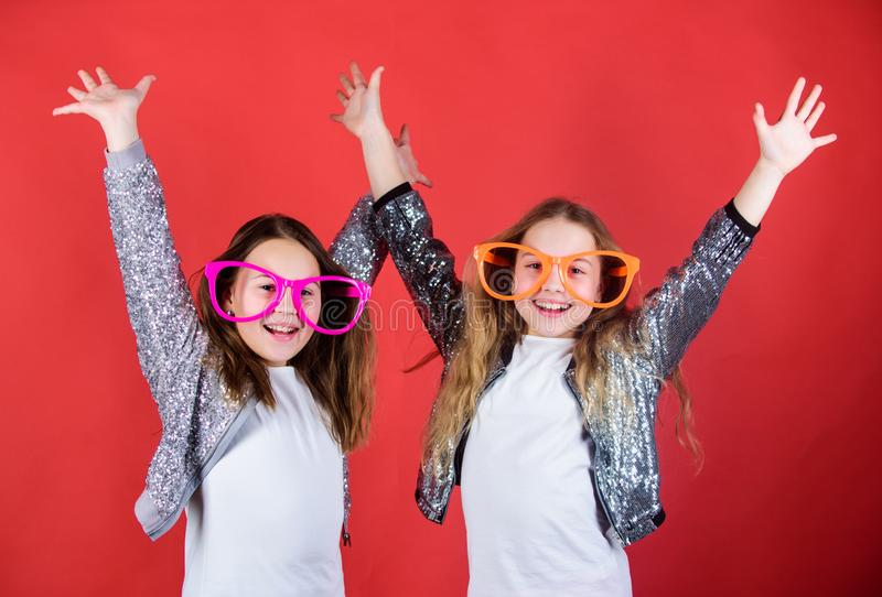 Joyful and cheerful. Sisterhood concept. Friendly relations siblings. Sincere cheerful kids share happiness and love royalty free stock images