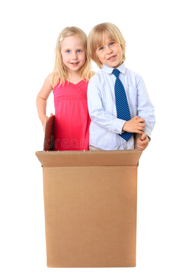 Download Joyful Children Look Out From A Cardboard Box Stock Photo - Image: 14812092