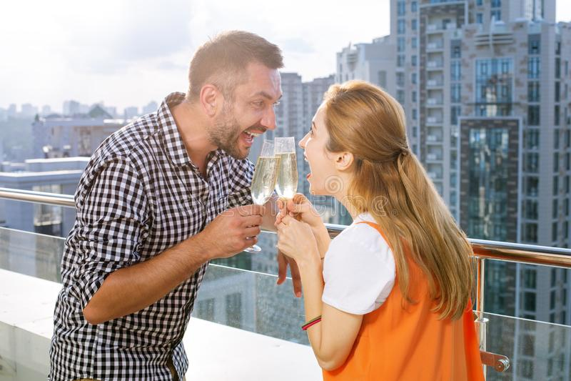 Joyful delighted married couple having a celebration royalty free stock photos