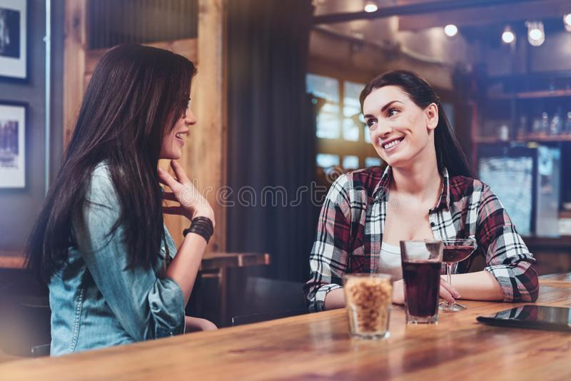 Joyful delighted women having a conversation royalty free stock photography