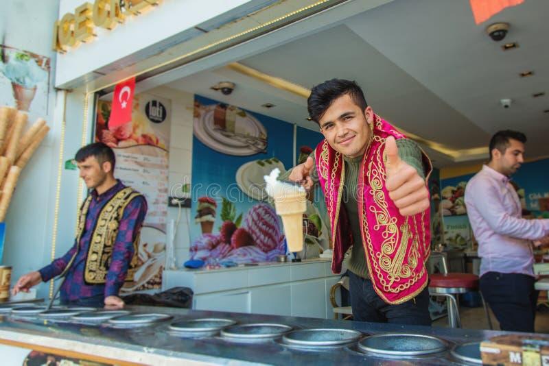 Joyful dondurma ice-cream seller dressed in traditional Turkish costume royalty free stock image