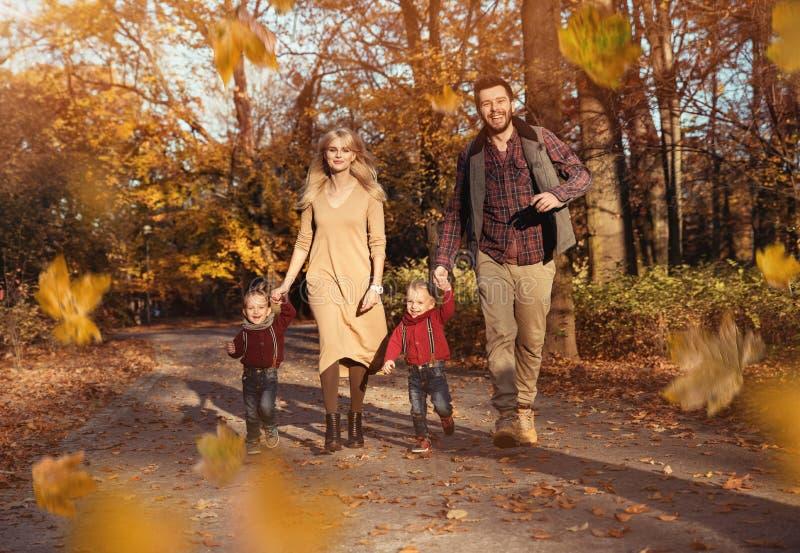 Joyful family enjoying great, autumnal weather stock images