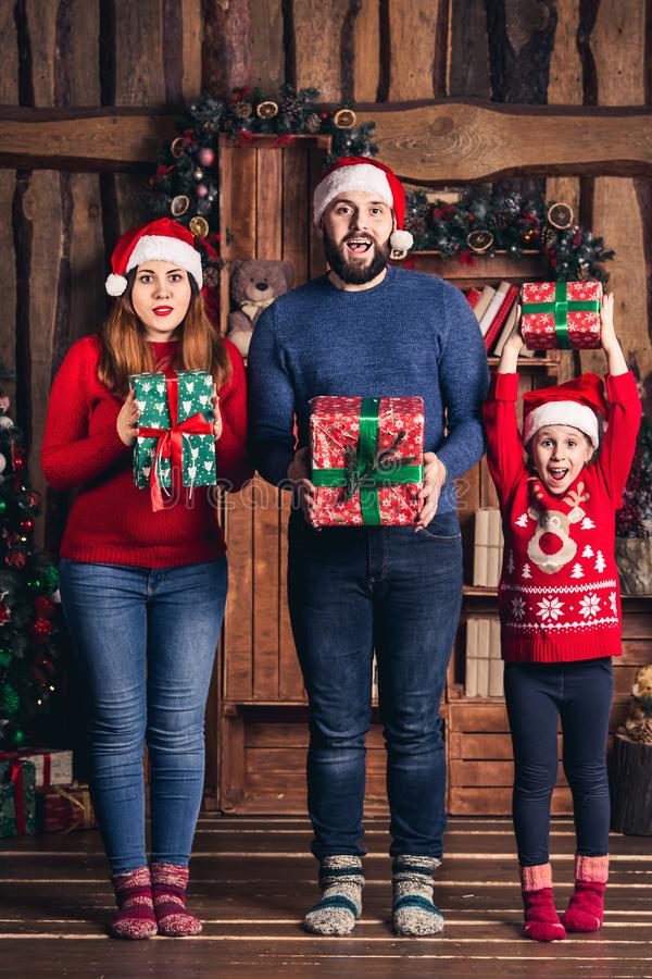 Joyful family with gifts in their hands for Christmas. stock image