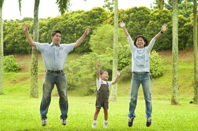 Joyful family jumping together royalty free stock images