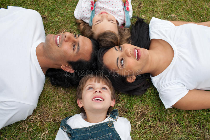 Download Joyful Family Lying In A Circle On The Grass Stock Image - Image: 12446067